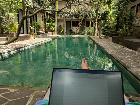 Writing by the pool in Bali