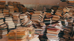 pile-of-books-scattered-on-the-floor-in-the-library_bfysuizh_thumbnail-full01