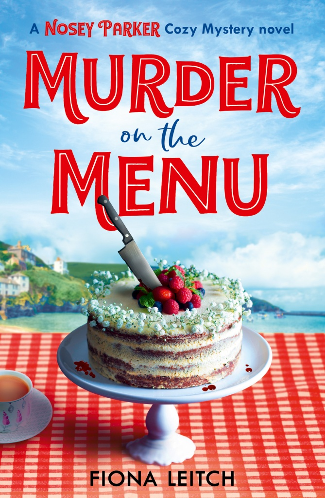 Cover of Murder on the Menu. Wedding cake in the foreground with a sharp knife sticking out of it. In the background, the coastline of Cornwall.