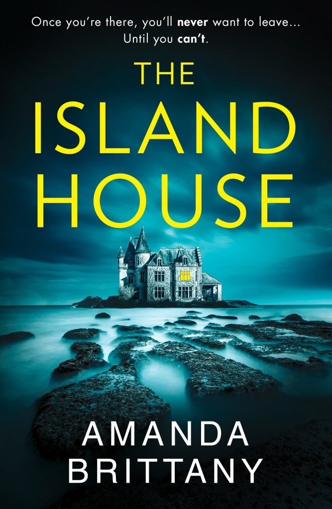 Cover of The Island House by Amanda Brittany Ocean rocks in the foreground, eerie island in the background. Large stone house on the island with one room lit up. Tagline: Once you're there, you'll never want to leave... Until you can't