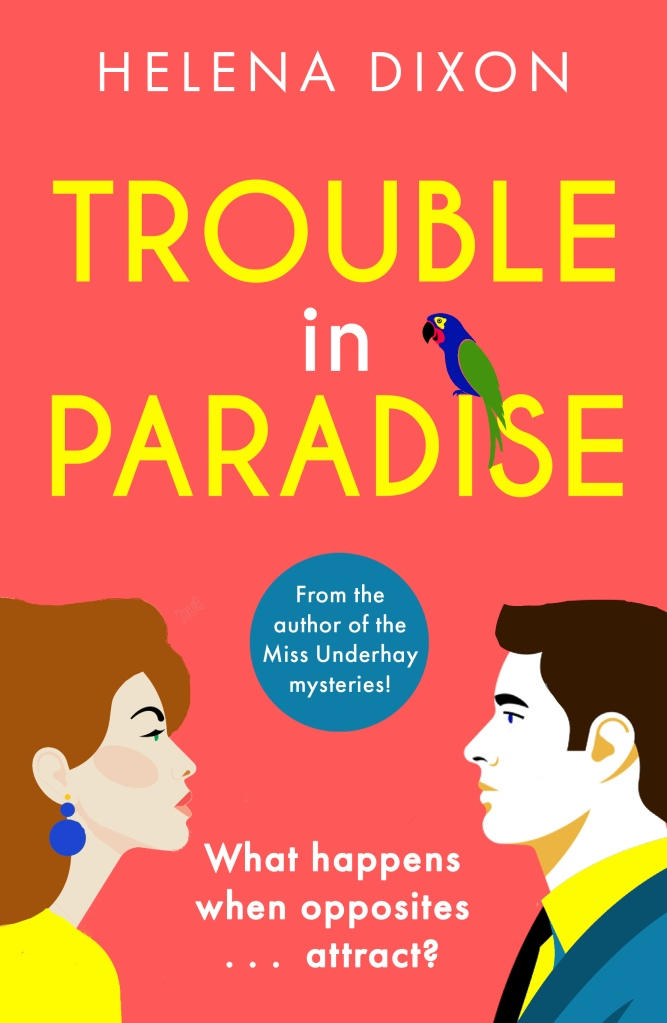 Cover of Trouble in Paradise by Helena Dixon Man on right with dark hair facing woman on left with red hair. A parrot sits in the 'i' in Paradise.  Tagline: What happens when opposites attract?'