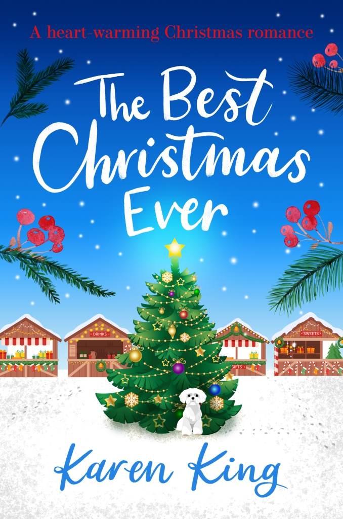 Cover of The Best Christmas Ever by Karen King. Four stalls at a Christmas market across the background under a starry sky and a Christmas tree and white dog in the foreground.